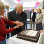 Trustee Sue Bagshaw cuts the cake with our first patient Ross Clapp at the birthday celebrations.
